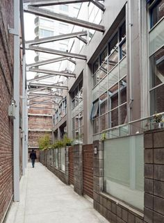 Warehouse Loft Renovation in San Francisco with an internal courtyard/walkway created from new and old walls.