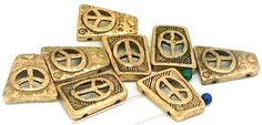 7 Peace Hippie Antique Gold 2 Hole Sliders  by MobileBoutiqueshop  Come check out our unique beads and clasps.