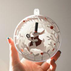 Artist Fills Ornaments With Paper Scenes From 'Alice in Wonderland' | Mental Floss  http://www.mentalfloss.com/article/70175/artist-fills-ornaments-paper-scenes-alice-wonderland