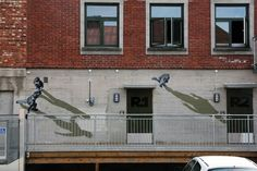 These black and white figures are so realistic, pedestrians might be mystified when they pass by this wall mural by Norwegian stencil artist Anders Gjennestad. Also known as Strøk, the artist utilizes all kinds of visual tricks, including distorted perspective and strong shadows, to produce illusions of people walking sideways on walls.