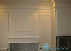 Close the space above kitchen cabinets with millwork.
