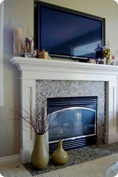 Since the TV will have to go above the fireplace, I must still find a way to decorate the mantle. I like the simplicity of this.
