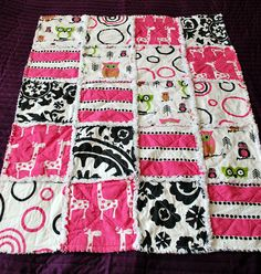 *I* made this baby rag quilt for my niece!! I bought a kit on etsy with the fabric precut and I followed the instructions and info I found online. It was awesome and super easy (and I am a very new sewer). I can't wait to make more.
