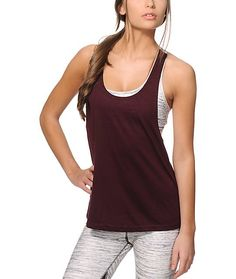 From the track to the yoga studio, get the convenience of this two-in-one tank top that comes equip with a built-in space dye print sports bra.