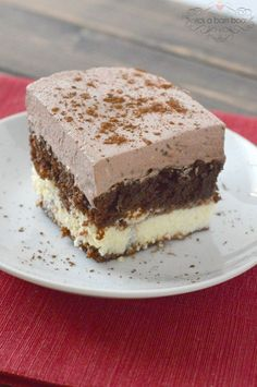 Chocolate Italian Cake -  It is a chocolate cake, sitting on a layer of sweet and creamy cheese, all topped with a light and chocolaty whipped frosting.  It's an Italian cake because of the cheese layer, which is made with ricotta.