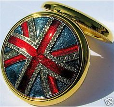 own it and love it. collectable estee lauder jeweled union jack powder compact.