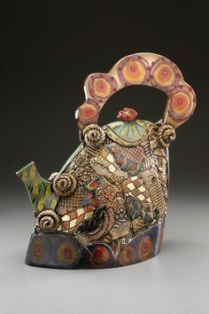 textured clay teapot