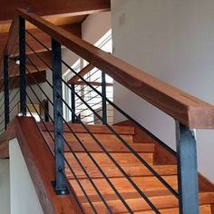 Features wood cap and raw steel finish. Great alternative to expensive cable rail! Wood Stair Handrail, Porch Handrails, Outdoor Stair Railing, Interior Stair Railing, Modern Stair Railing, Steel Handrail, Stair Railing Design, Metal Stairs, Modern Stairs