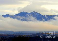 Mountains wrapped in clouds 4 by Diane M Dittus