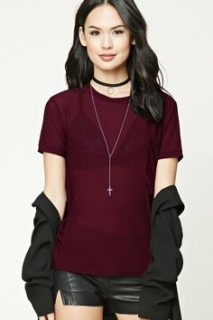Style Deals - A sheer mesh tee featuring a round neckline and short sleeves.