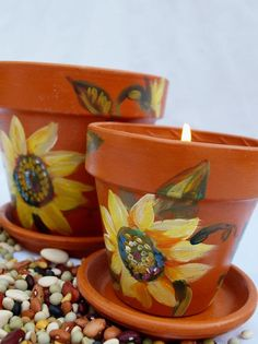 "Items similar to 2 Wedding Candle Holders or Centerpiece Container, Terra Cotta ""Sunflower"" Pots, by Green Orchid Design Studio on Etsy Flower Pot Art, Flower Pot Crafts, Clay Pot Projects, Clay Pot Crafts, Painted Clay Pots, Painted Flower Pots, Flower Pot People, Terracotta Flower Pots, Candle Holders Wedding"
