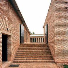 Education centre in Rwanda built from brick  and wicker by Dominikus Stark Architekten  http://www.dominikusstark.de/2010/education-center-nyanza-ruanda/