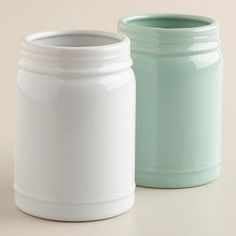 "With an open top and ""mason"" embossed onto each one, these aqua and white ceramic vases are sure to bring a nostalgic feel to your home décor. >> #WorldMarket Kitchen Accessories, Mason Jars"