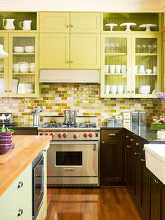 Small, Sleek Tiles -These colorful ceramic tiles provide a fresh take on the classic white subway pattern. The tiles are smaller -- 2x4 inches -- than traditional 3x6-inch subway tiles, making the look sleeker. The backsplash, combined with the green cabinetry and the natural light from the kitchen windows, balance the dark mahogany cabinets in this lively kitchen.