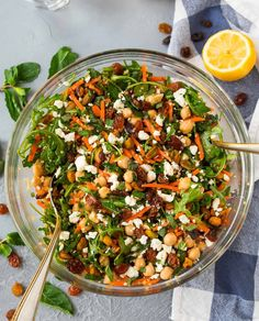 Moroccan Chickpea Salad with Carrots, Quinoa, and Feta. A bright, filling, healthy salad filled with Moroccan spices and fresh ingredients. Get the recipe here!