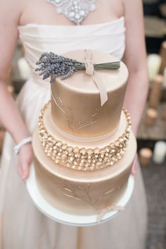 Gold wedding cake with lavender springs cake topper | LH Photography | see more on http://burnettsboards.com/2014/02/glamorous-creative-love-sweet-shoot/