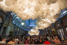 French artist and photographer Charles Pétillion has just unveiled a cumulus cloud composed of 100,000 white balloons illuminated from the inside at London's Covent Garden. Titled 'Heartbeat,' the installation was created as part of the upcoming London Design Festival and stretches the length of the
