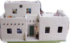 Two story Adobe Ellsworth Dollhouse Kit~Image via Earth and Tree Dollhouses and Miniatures