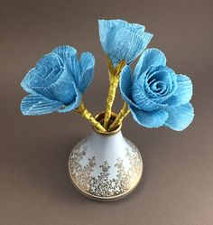 These small roses are made with blue crepe paper and are arranged in a vintage vase. The pale blue vase features intricate gold designs and was made in France. Original Artwork by Kelly Bloom Small Rose, Vintage Vases, Unique Gifts, Handmade Gifts, Crepe Paper, Paper Roses, Etsy Seller, Gold Designs, Etsy Shop