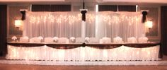 Backdrop & headtable with chocolate organza swag