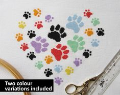 ***Two colour variations are included in this listing*** Cross stitch patterns of a heart made up of paw prints. Separate charts giving different colour variations of the same pattern are included in this listing - one in pink, purple and black and one in rainbow colours and