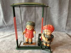 Japan C. 1930's Celluloid Boy with Girl on Swing Tin Wind-Up