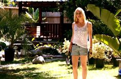 I love Hannah McKay's style on Dexter: flowy, feminine tops with cuffed denim shorts and combat boots.  So casual and summery yet stylish!