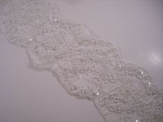 White Beaded Reeimbroidered Floral Design Galloon Lace Trim--One Yard. $14.95, via Etsy.