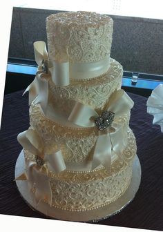 Love this cake...except with maybe a little less detail and without the bows