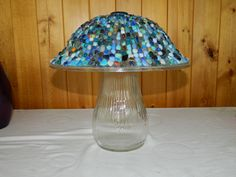 Glass Garden Mushroom totem. I made it out of a flower vase and a light fixture that I glued blue colored glass stones to.