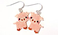 Heres something to squeal about! Affectionate, peachy-cute farmyard piggies make up this lightweight and fun earrings. Hand stitched, one itty-bitty