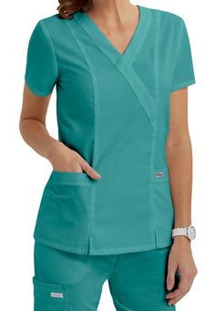 Shop for solid scrub tops in vibrant colors and comfortable styles at Scrubs & Beyond. We carry solid scrub tops made by all of the most trusted brands. Healthcare Uniforms, Medical Uniforms, Scrubs Outfit, Scrubs Uniform, Scrubs Pattern, Cute Scrubs, Medical Scrubs, Scrub Tops, Comfortable Fashion