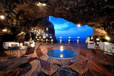 Exclusive Italian restaurant called The Summer Cave, located in Polignano a Mare at the boutique Grotta Palasezze hotel