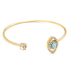 Gold Evil Eye Cuff . A gold toned open cuff bracelet. A blue evil eye on one side and a clear stone on the other. This bracelet is the perfect accessory