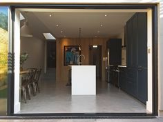 The aluminium doors slide across the fixed window past the column leaving an unimpeded transition between inside and out