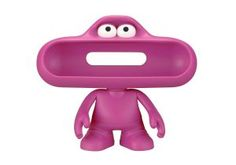 Beats By Dre pill character (Pink)  Product Highlights:									Stand for Your pill Speaker													Access to Audio & Charging Ports													Moveable Arms & Head											Overview:  Check Out Beats By Dr Dre Pink. Free UK Delivery on Eligible Orders. More Info: http://www.loveheadphone.co.uk/beats-by-dr-dre-pink.html