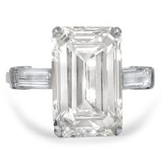 The Palomino Ring. This awe-inspiring piece showcases a 7 carat emerald cut diamond in a platinum setting. Two baguette cut diamond accents adorn the shoulders for an impressive classic look (approx. 8.40 total carat weight).
