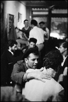 Writer Jack Kerouac shows affection to an admirer at Seven Arts Coffee Gallery, 1959.