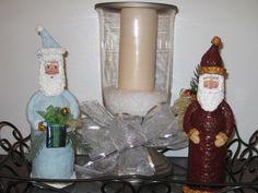 Paper Mache Santa's I made on glass bottles