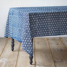 "Hand-printed by skilled artisans, this cotton tablecloth is dyed with rich, natural indigo. A crisp, geometric pattern enlivens the kitchen.- Cotton- Wash before first use- Machine wash cold on delicate cycle, separate from other items. Use mild detergent. Line dry.- Natural dye color may vary slightly- Handmade in India59""W, 110.25""L"