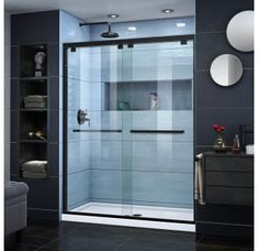 DreamLine Encore H x to W Semi-Frameless Bypass/Sliding Satin Black Shower Door at Lowe's. The DreamLine Encore bypass sliding shower or tub door has a modern frameless look to make your shower the focal point of the bathroom. Robin Day, Frameless Sliding Shower Doors, Shower Base, Shower Kits, Shower Ideas, Shower Enclosure, Bathtub Shower, Glass Shower, Bathtub Doors