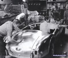 Today, after a hiatus, FORD resurrected the name with the introduction of the 2016 Shelby Mustang. Over Pictured here, Carroll Shelby at work on the original 1962 Shelby Cobra / © Shelby American Inc Cobra Art, Ac Cobra, King Cobra, Shelby Car, Shelby Daytona, Shelby Gt500, 1965 Mustang, Carroll Shelby, Car Prices