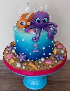 Under the sea birthday cake blue sea ocean ombre airbrush on buttercream fondant octopus and fish and seashells