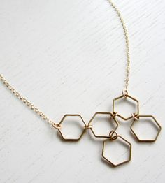 Asymmetrical Honeycomb Necklace   Antiqued brass hexagons are arranged in an organic composition...   Necklaces