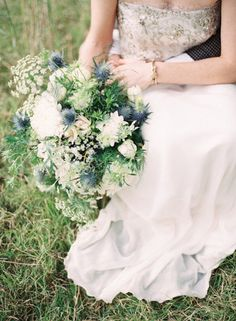 Wild-looking blue thistle bouquet, love these blues, champagnes for Dave and Lisa. Picks up the nice grays of the hotel too!