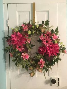 PASSIONATE PINK Wreath is a hot pink concoction of dahlias, peonies, cone flowers and blooming branches amid assorted greenery and trailing vines. Created on an 18 grapevine base; recommended for interior or protected exterior use. Each wreath is custom made and may vary