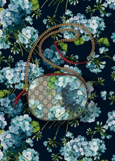 Gucci Blue Blooms: A House print finds new expression for fall, bunches of geraniums in shades of blue are scattered across GG motif on leather-trimmed bags and wallets.