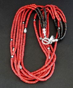 This vibrant Necklace showcases six strands of Red Coral Heishi, precisely cut to 5mm in diameter. The Heishi is deep red in color and has a glossy sheen, guaranteed to brighten your day. We've highli