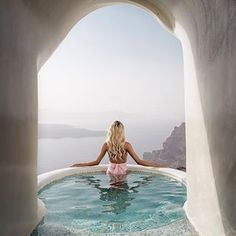 Breathtaking view...Photoshoot for @alexandra_panagiotarou swimwear collection at Santorini