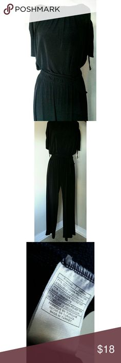 "Black Jumpsuit Romper Size Large. 56"" bust. 28"" around waist but material stretches. 44"" hip. Comes with belt. Right side missing loop where belt goes into. Very roomy, comfy, stretchy jumpsuit. Questions are welcomed. Tiana B Pants Jumpsuits & Rompers"